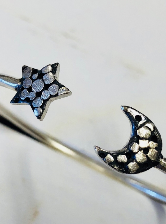Young British Designers: PALLENBERG SILVER STAR AND MOON CUFF by Peculiar Vintage